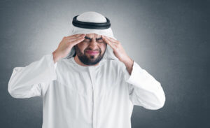 arabian man with a headache - clipping path included