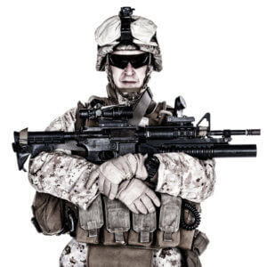 US marine with his assault rifle on white background