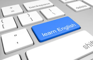 Learn English key on a computer keyboard for online classes on speaking, reading, and writing the language
